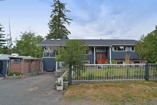 Photo 1: 20261 48 Avenue in Langley: Langley City House for sale : MLS®# R2101946
