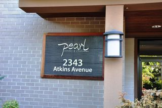 """Photo 1: 103 2343 ATKINS Avenue in Port Coquitlam: Central Pt Coquitlam Condo for sale in """"THE PEARL"""" : MLS®# R2203416"""