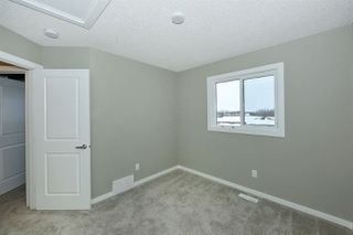 Photo 14: 1168 ROSENTHAL Boulevard in Edmonton: Zone 58 Attached Home for sale : MLS®# E4139019
