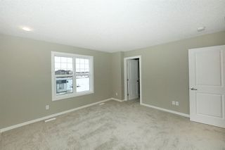 Photo 17: 1168 ROSENTHAL Boulevard in Edmonton: Zone 58 Attached Home for sale : MLS®# E4139019