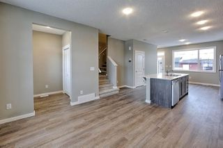 Photo 6: 1168 ROSENTHAL Boulevard in Edmonton: Zone 58 Attached Home for sale : MLS®# E4139019