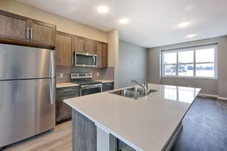 Photo 1: 1168 ROSENTHAL Boulevard in Edmonton: Zone 58 Attached Home for sale : MLS®# E4139019