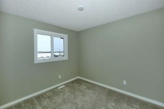 Photo 13: 1168 ROSENTHAL Boulevard in Edmonton: Zone 58 Attached Home for sale : MLS®# E4139019