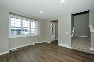 Photo 5: 1168 ROSENTHAL Boulevard in Edmonton: Zone 58 Attached Home for sale : MLS®# E4139019