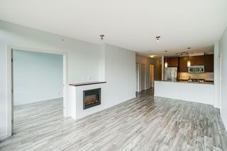 "Photo 5: 605 110 BREW Street in Port Moody: Port Moody Centre Condo for sale in ""ARIA 1"" : MLS®# R2370460"