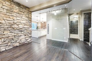 Photo 5: 22 ROCK LAKE View NW in Calgary: Rocky Ridge Detached for sale : MLS®# C4285208