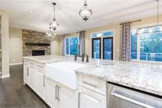 Photo 7: 22 ROCK LAKE View NW in Calgary: Rocky Ridge Detached for sale : MLS®# C4285208