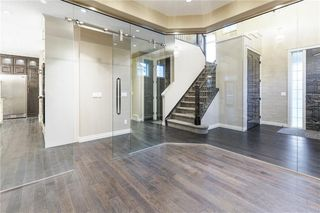 Photo 3: 22 ROCK LAKE View NW in Calgary: Rocky Ridge Detached for sale : MLS®# C4285208
