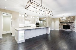 Photo 9: 22 ROCK LAKE View NW in Calgary: Rocky Ridge Detached for sale : MLS®# C4285208