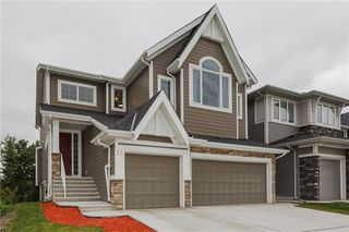 Photo 2: 22 ROCK LAKE View NW in Calgary: Rocky Ridge Detached for sale : MLS®# C4285208
