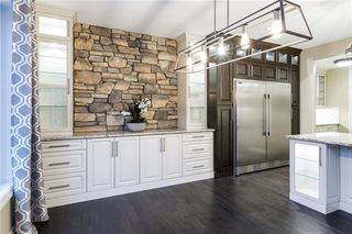 Photo 18: 22 ROCK LAKE View NW in Calgary: Rocky Ridge Detached for sale : MLS®# C4285208