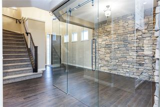 Photo 4: 22 ROCK LAKE View NW in Calgary: Rocky Ridge Detached for sale : MLS®# C4285208