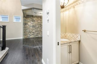Photo 21: 22 ROCK LAKE View NW in Calgary: Rocky Ridge Detached for sale : MLS®# C4285208