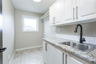 Photo 31: 22 ROCK LAKE View NW in Calgary: Rocky Ridge Detached for sale : MLS®# C4285208