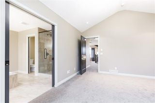 Photo 33: 22 ROCK LAKE View NW in Calgary: Rocky Ridge Detached for sale : MLS®# C4285208