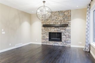 Photo 8: 22 ROCK LAKE View NW in Calgary: Rocky Ridge Detached for sale : MLS®# C4285208