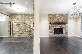Photo 6: 22 ROCK LAKE View NW in Calgary: Rocky Ridge Detached for sale : MLS®# C4285208