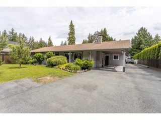 """Photo 1: 3926 204A Street in Langley: Brookswood Langley House for sale in """"Brookswood"""" : MLS®# R2461276"""