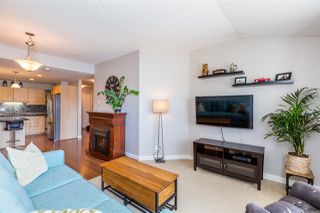 Photo 2: 307 19774 56 Avenue in Langley: Langley City Condo for sale : MLS®# R2437992