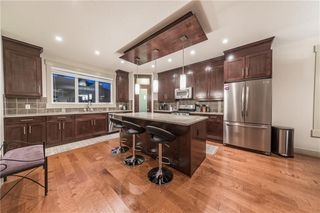 Photo 8: 1126 17 Avenue NW in Calgary: Capitol Hill Semi Detached for sale : MLS®# A1042734