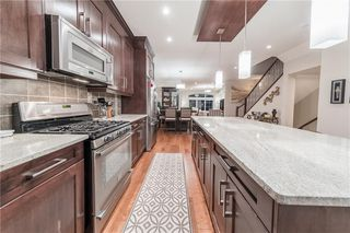 Photo 3: 1126 17 Avenue NW in Calgary: Capitol Hill Semi Detached for sale : MLS®# A1042734