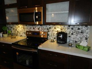 """Photo 4: 404 2138 OLD DOLLARTON Road in North Vancouver: Seymour Condo for sale in """"MAPLEWOOD NORTH"""" : MLS®# V902282"""