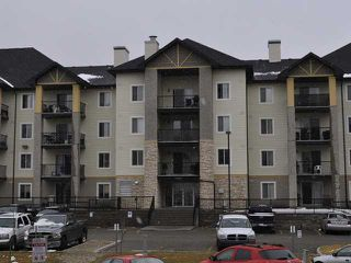 Photo 1: 8105 304 MACKENZIE Way SW: Airdrie Condo for sale : MLS®# C3613949