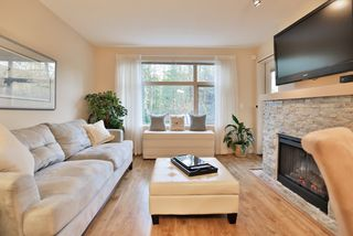 "Photo 3: 102 400 KLAHANIE Drive in Port Moody: Port Moody Centre Condo for sale in ""TIDES"" : MLS®# R2013966"