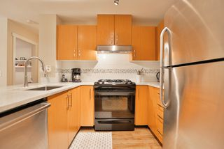 """Photo 9: 102 400 KLAHANIE Drive in Port Moody: Port Moody Centre Condo for sale in """"TIDES"""" : MLS®# R2013966"""
