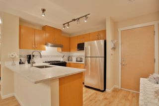 "Photo 7: 102 400 KLAHANIE Drive in Port Moody: Port Moody Centre Condo for sale in ""TIDES"" : MLS®# R2013966"