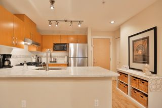 """Photo 8: 102 400 KLAHANIE Drive in Port Moody: Port Moody Centre Condo for sale in """"TIDES"""" : MLS®# R2013966"""