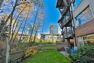 "Photo 1: 102 400 KLAHANIE Drive in Port Moody: Port Moody Centre Condo for sale in ""TIDES"" : MLS®# R2013966"