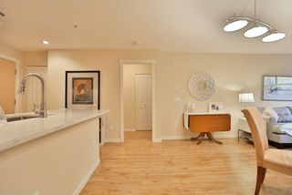 "Photo 11: 102 400 KLAHANIE Drive in Port Moody: Port Moody Centre Condo for sale in ""TIDES"" : MLS®# R2013966"