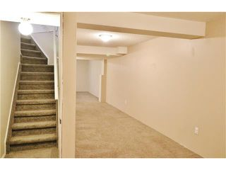 Photo 17: 100 RIVER ROCK Circle SE in Calgary: Riverbend House for sale : MLS®# C4088178