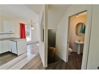 Photo 5: 100 RIVER ROCK Circle SE in Calgary: Riverbend House for sale : MLS®# C4088178