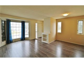 Photo 2: 100 RIVER ROCK Circle SE in Calgary: Riverbend House for sale : MLS®# C4088178