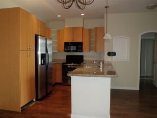 """Photo 4: 407 33485 S FRASER Way in Abbotsford: Central Abbotsford Condo for sale in """"Citadel Ridge"""" : MLS®# R2167578"""