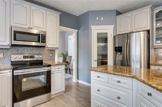 Photo 9: 85 STRATHRIDGE Crescent SW in Calgary: Strathcona Park Detached for sale : MLS®# C4233031