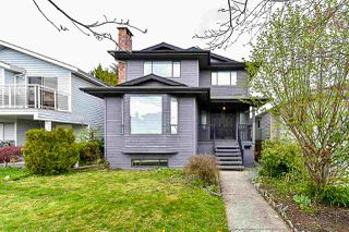Photo 1: 7642 HILDA Street in Burnaby: Edmonds BE House for sale (Burnaby East)  : MLS®# R2374423