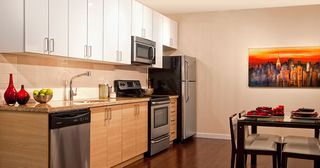"Photo 4: PH3 3688 Inverness Street in Vancouver: Condo for sale in ""Charm"""