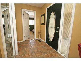 Photo 3: 12451 LAKE FRASER Way SE in CALGARY: Lake Bonavista Residential Detached Single Family for sale (Calgary)  : MLS®# C3617962