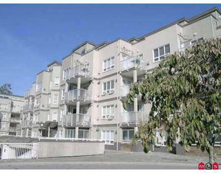 "Photo 1: 104 14399 103RD AV in Surrey: Whalley Condo for sale in ""Claridge Court"" (North Surrey)  : MLS®# F2505216"