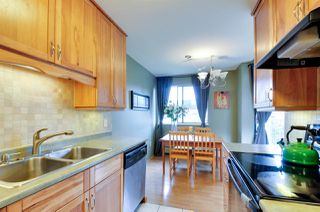 """Photo 7: 312 3901 CARRIGAN Court in Burnaby: Government Road Condo for sale in """"LOUGHEED ESTATES"""" (Burnaby North)  : MLS®# R2039778"""