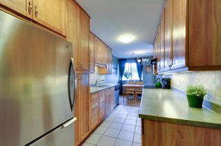"""Photo 8: 312 3901 CARRIGAN Court in Burnaby: Government Road Condo for sale in """"LOUGHEED ESTATES"""" (Burnaby North)  : MLS®# R2039778"""