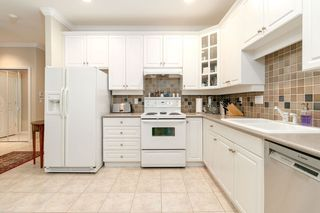 """Photo 5: 405 3280 PLATEAU Boulevard in Coquitlam: Westwood Plateau Condo for sale in """"CAMELBACK"""" : MLS®# R2367724"""
