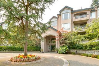 "Photo 1: 405 3280 PLATEAU Boulevard in Coquitlam: Westwood Plateau Condo for sale in ""CAMELBACK"" : MLS®# R2367724"