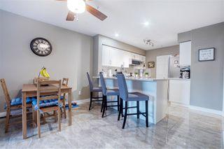 "Photo 9: 202 13860 70 Avenue in Surrey: East Newton Condo for sale in ""Chelsea Gardens"" : MLS®# R2526715"