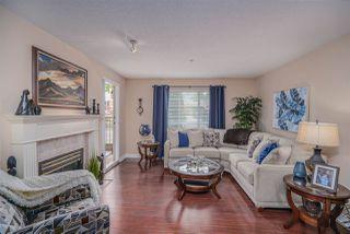 "Main Photo: 202 13860 70 Avenue in Surrey: East Newton Condo for sale in ""Chelsea Gardens"" : MLS®# R2526715"