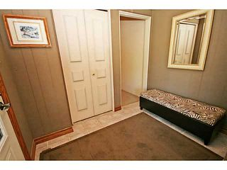 Photo 2: 12 LAKE LINNET Close SE in Calgary: Lake Bonavista Residential Detached Single Family for sale : MLS®# C3641597