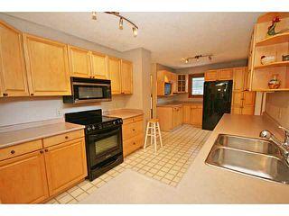Photo 5: 12 LAKE LINNET Close SE in Calgary: Lake Bonavista Residential Detached Single Family for sale : MLS®# C3641597